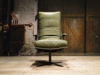 inudstriele groene fauteuil